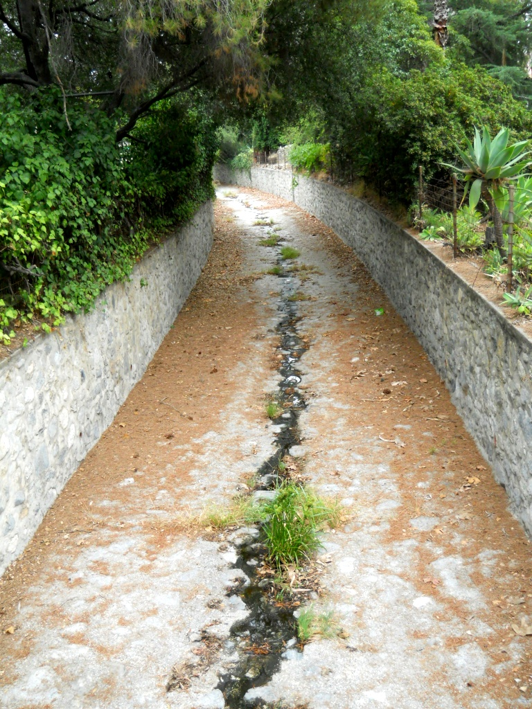 The storm drains are lined with river rock